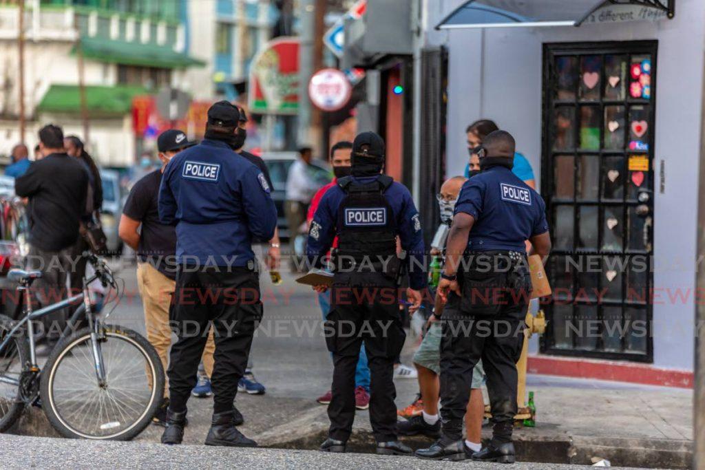 Police on duty in Woodbrook. File photo/Jeff K Mayers -