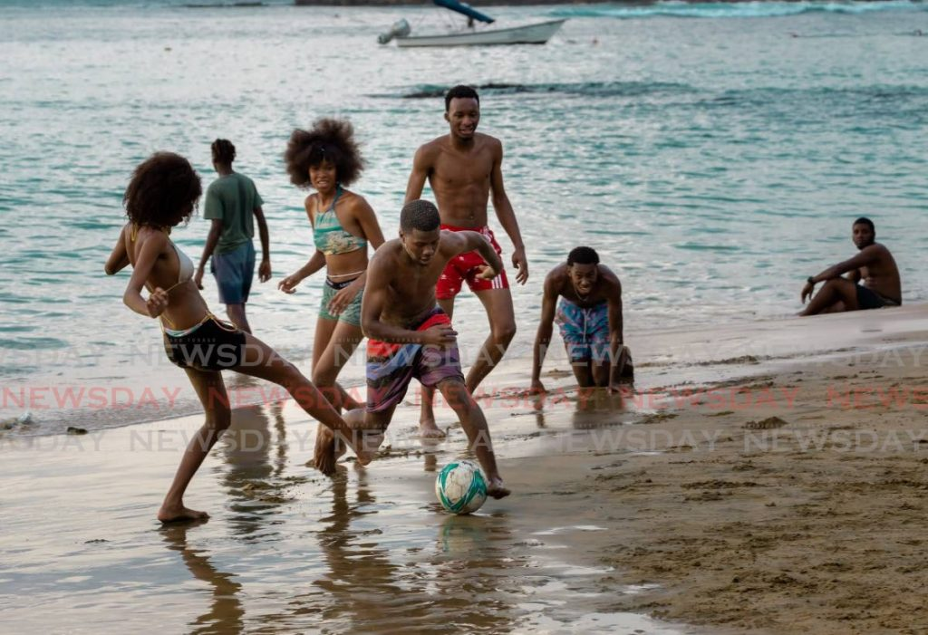 A lively game of football is played at Mt Irvine Beach earlier this year. FILE PHOTO/DAVID REID  -