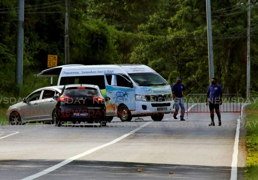 Chaguaramas Development Authority estate constables turn away drivers at Tucker Valley Road on May 16, 2021. The CDA on Saturday access to the area is once again restricted owing to large crowds on the Republic Day holiday on Friday. - File photo/Sureash Cholai