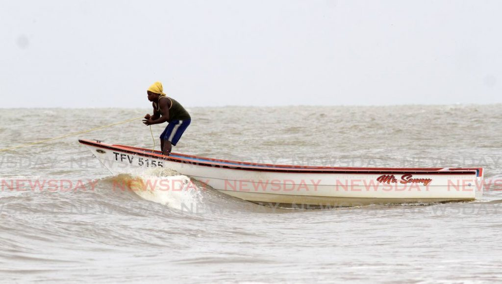 A fisherman anchors his pirogue on Grand Chemin Beach, Moruga on July 6, 2021. File photo/Angelo Marcelle  -