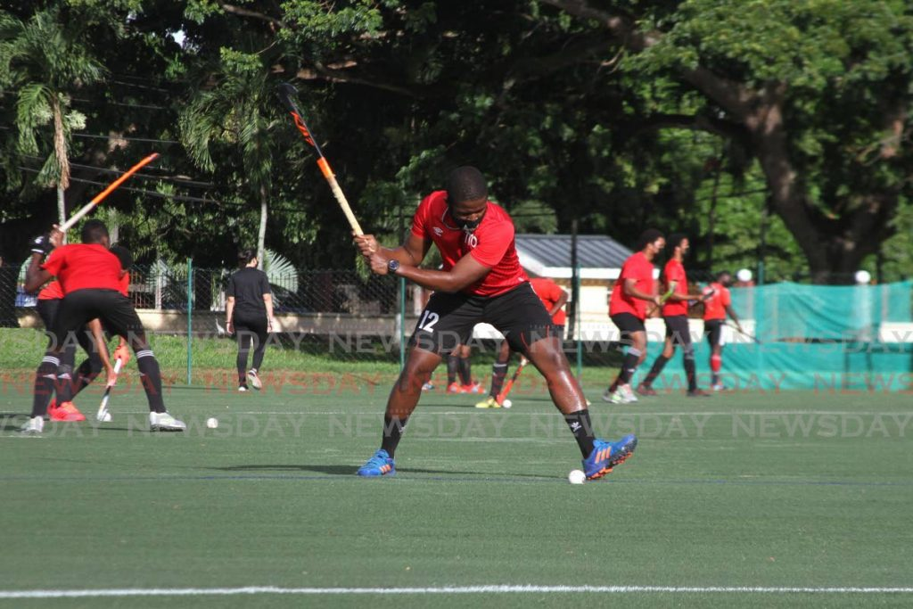 The TT men's Under-21 hockey team during a practice session at the Police Barracks, St James, on July 22.  - Photo by Marvin Hamilton