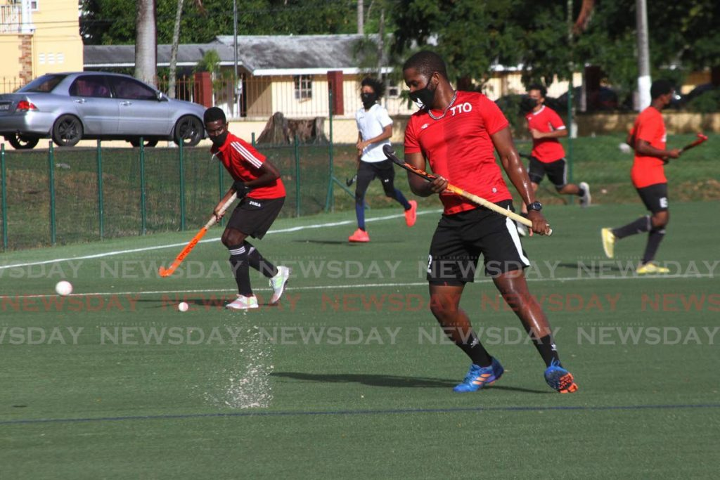 The Trinidad and Tobago Under 21 men's hockey team attend a training session at the Police Barracks, St James on July 22.  - Marvin Hamilton