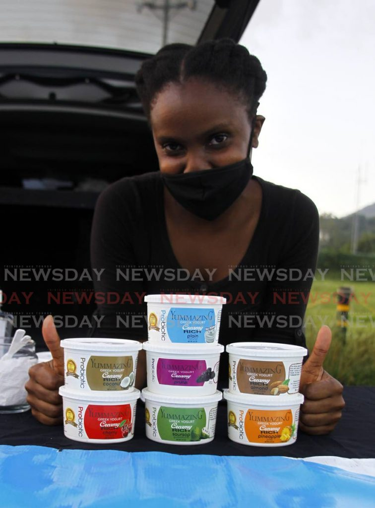 Jewel Bruce of Yummazing Creamry with locally-made Greek yoghurt products on sale at Queen's Park Savannah, Port of Spain on July 30. The TTCSI has launched an initiative to help the services sector to expand export opportunities. - PHOTO BY ROGER JACOB