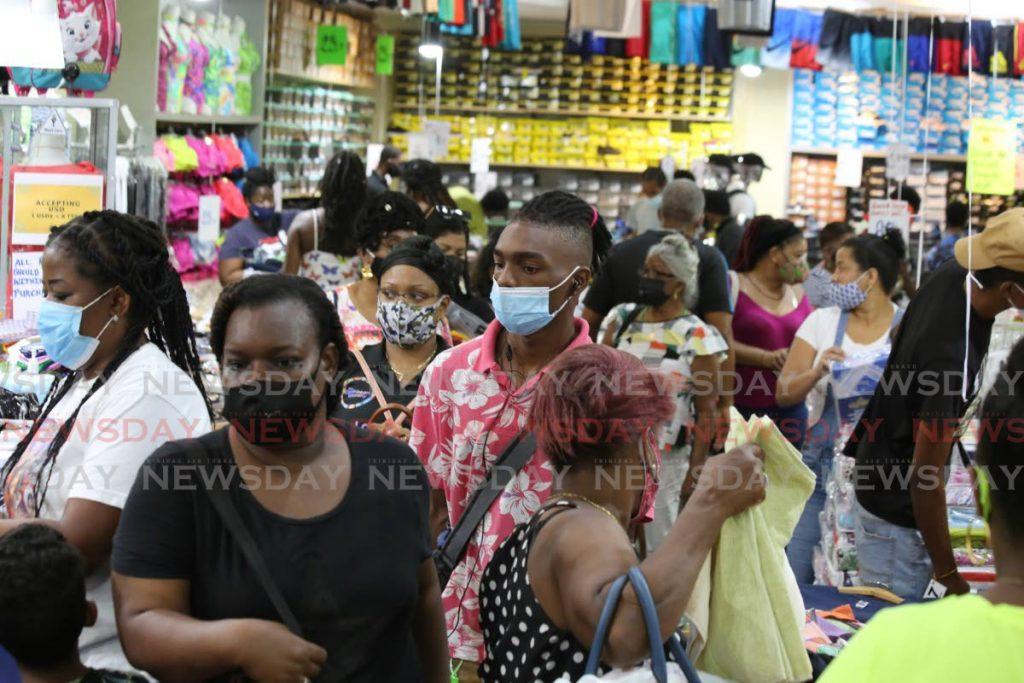 In this file photo, customers crowd UA Investment store on Frederick Street, Port of Spain on August 16 when retail stores reopened as part of the phased lifting of covid19 restrictions. Photo by Sureash Cholai -
