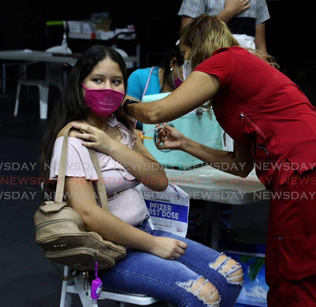 A Venezuelan woman being vaccinated at the National Academy for the Performing Arts. Photo by Sureash Cholai - SUREASH CHOLAI