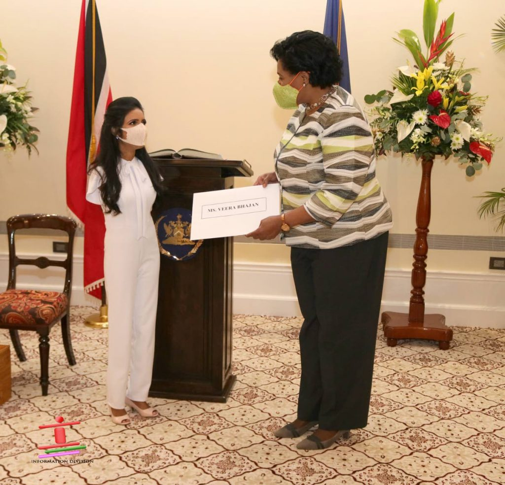 President Paula-Mae Weekes presents Veera Bhajan with her appointment letter as a lay assessor to the Equal Opportunities Tribunal on March 17, 2021. Photo courtesy Office of the President. -