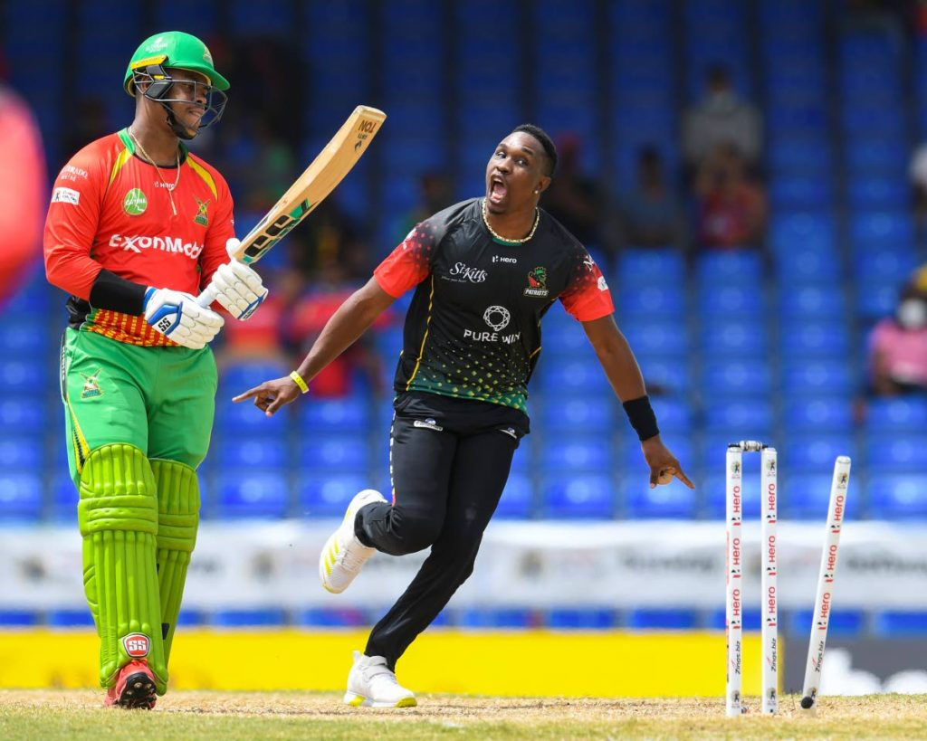In this Aug 28 file photo, Dwayne Bravo (R) of Saint Kitts & Nevis Patriots celebrates the dismissal of Shimron Hetmyer (L) of Guyana Amazon Warriors during the 2021 Hero Caribbean Premier League match 5, at Warner Park Sporting Complex, in Basseterre, St Kitts. Patriots won by eight wickets. - via CPL T20