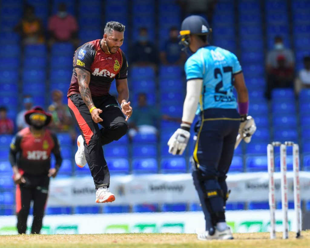 Ravi Rampaul (centre) of Trinbago Knight Riders celebrates the dismissal of Mark Deyal (right) of St Lucia Kings during the 2021 Hero Caribbean Premier League match 7 between St Lucia Kings and Trinbago Knight Riders at Warner Park Sporting Complex on August 29 in Basseterre, St Kitts. Rampaul was named in the 15-man West Indies squad for the ICC T20 World Cup.(Photo by CPL T20/Getty Images) -
