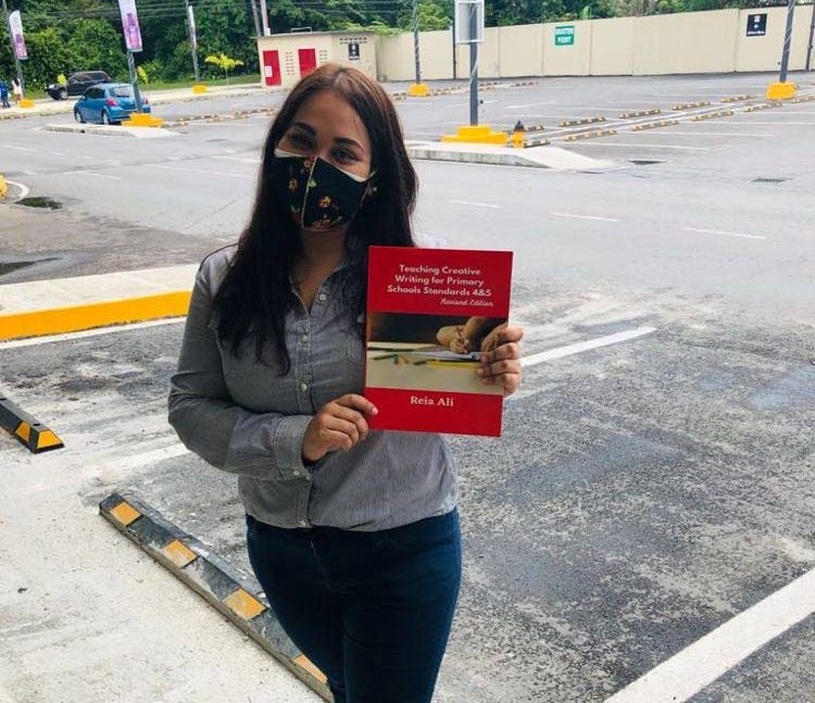 Teacher Reia Ali with her self-published textbook Teaching Creative Writing for Primary Schools Standards 4&5. -