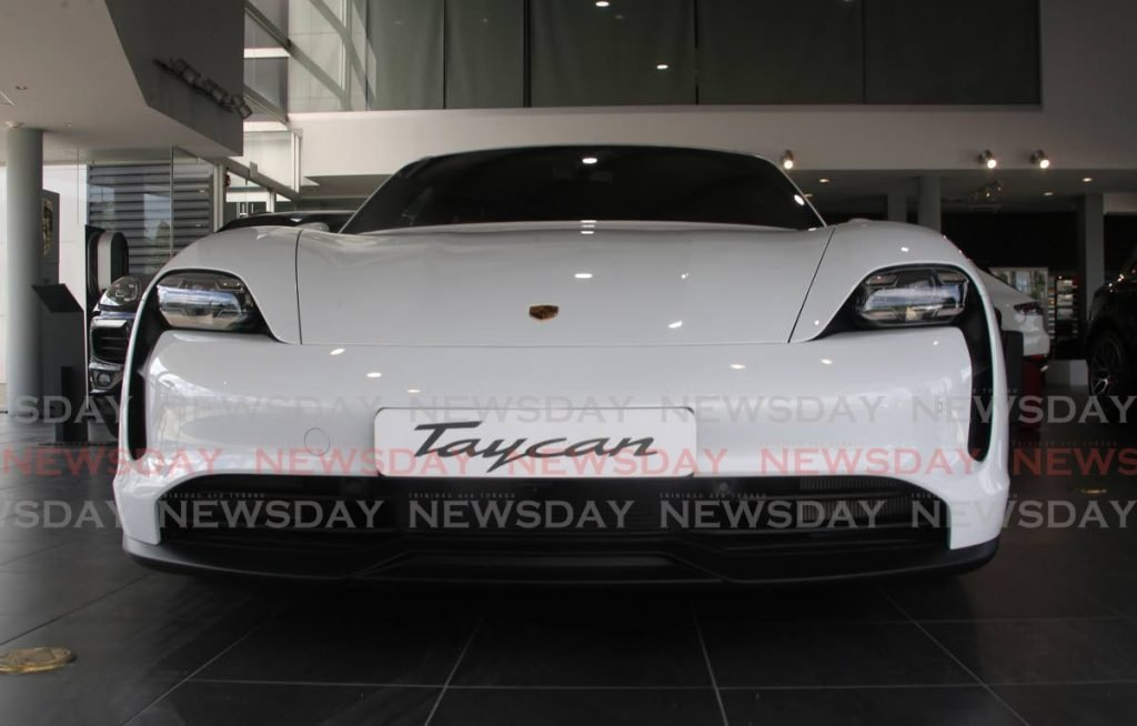 A Porsche Taycan. One of the Smart goals is to be specific. When buying a car find out the differences in the price of a new one or a used vehicle. - PHOTO BY SUREASH CHOLAI