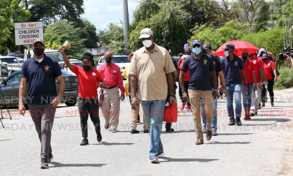 Trade union leaders march during the movement's 'freedom day walk' from Aranjuez savannah to Woodford Square, Port of Spain to protest against the state of the economy, unemployment, the state of emergency and mandatory vaccinations among other issues. - PHOTO BY SUREASH CHOLAI