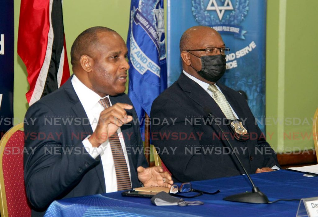 Director of Crime Stoppers Darrin Carmichael, left, addressed the media during a press conference at the Police Administration Building on Sackville Street, Port of Spain.  Also in the photo is Deputy Commissioner of Police, Intelligence and Investigations Mc Donald Jacob.   - Photo by Ayanna Kinsale
