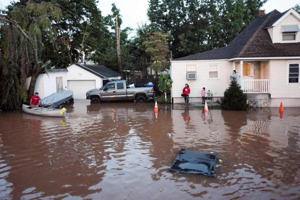 Residents are surrounded by floodwaters in the aftermath of Hurricane Ida in Manville, New Jersey on Thursday. (AP) -