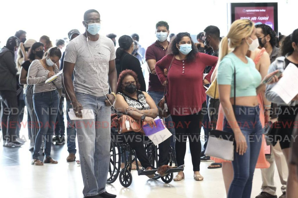 Hundreds of people turned up at Gulf City Mall, San Fenando on Saturday for the Pfizer vaccine, at the covid19 vaccination road trip by the SWRHA. - Photo by Lincoln Holder