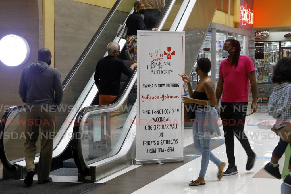 Shoppers head to an upper floor to receive the Johnson & Johnson vaccine at Long Circular Mall, St James on Saturday. - PHOTO BY ROGER JACOB