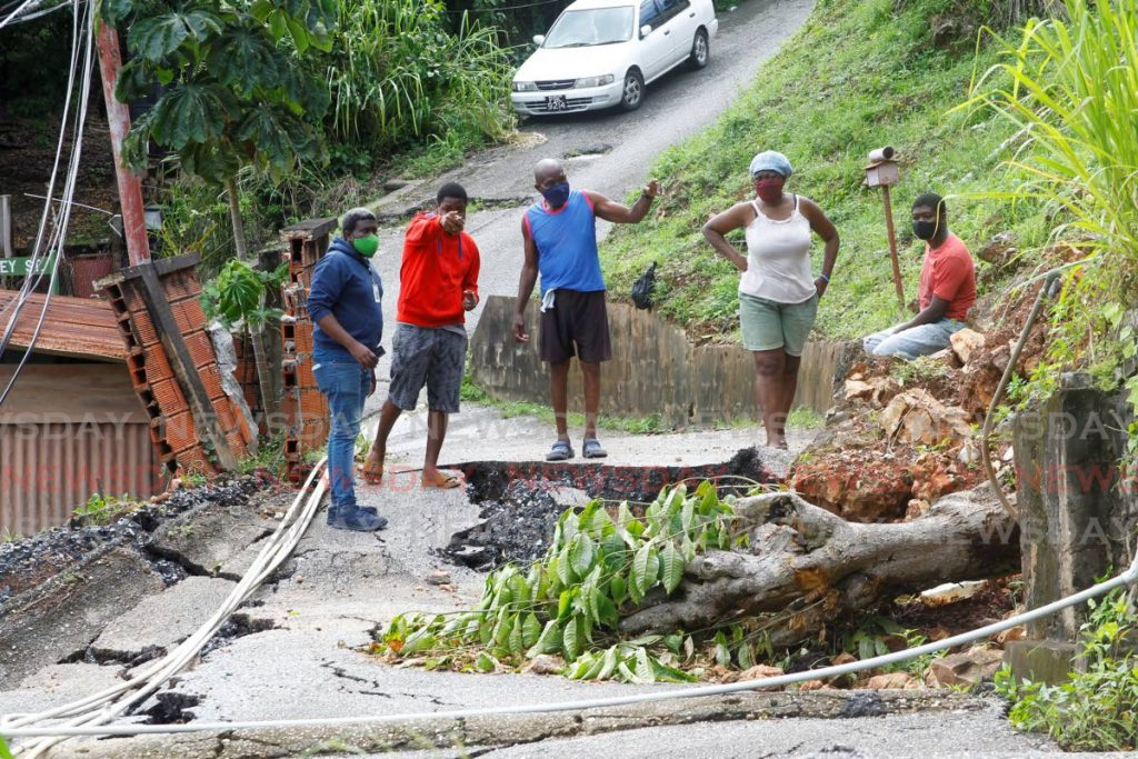 Abraham Lane off Upper Pashley Street in Laventille is impassable after land slippage caused a major crack along the road with retaining walls on the side of the road and even a tree collapsing in the process. PHOTO BY ROGER JACOB - ROGER JACOB
