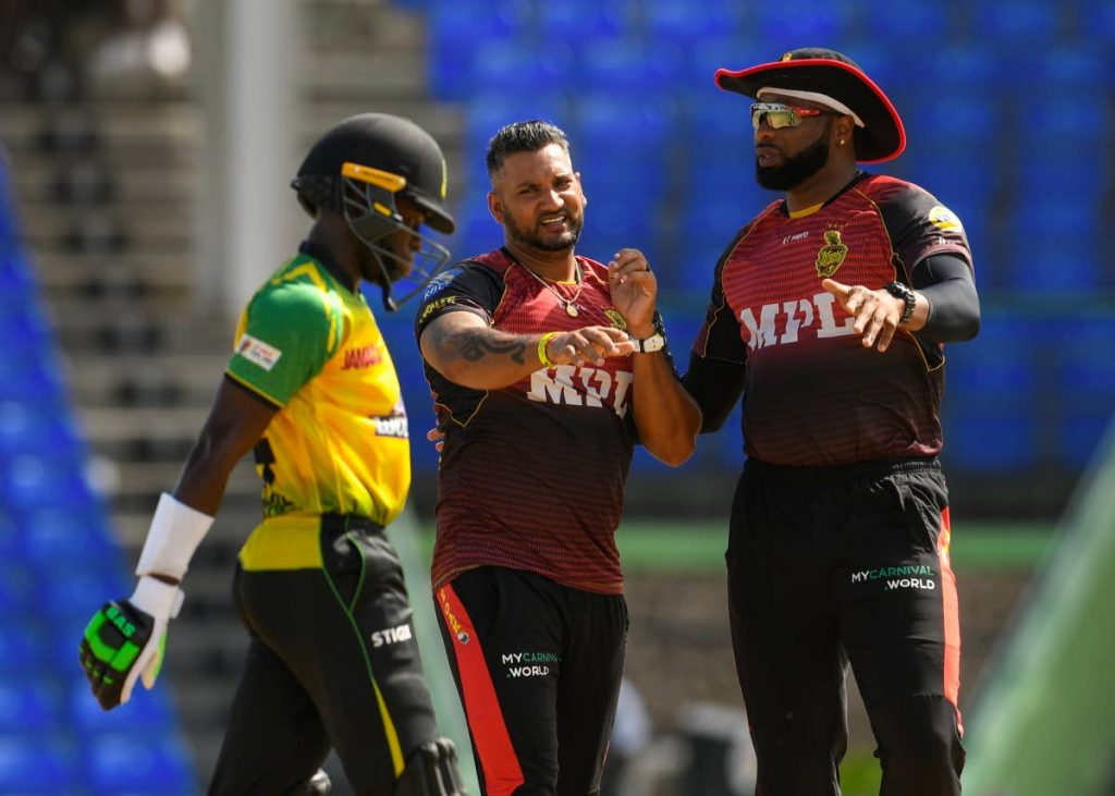 In this Sep 5 file photo, Ravi Rampaul (2R) and Kieron Pollard (R) of Trinbago Knight Riders celebrate the dismissal of Kirk Mckenzie (L) of Jamaica Tallawahs during the 2021 Hero Caribbean Premier League match 18 at Warner Park Sporting Complex in Basseterre, St Kitts. - Photo courtesy CPL T20