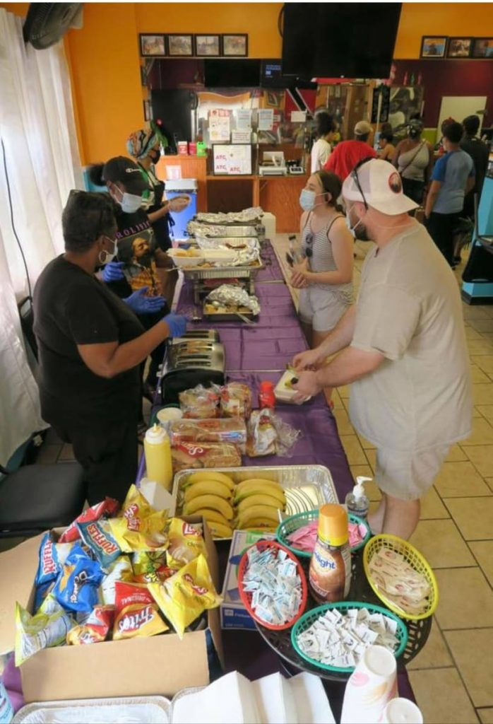 Volunteers at the food drive hosted by the owners of Island Paradise Restaurant and Grill. - Photos courtesy: Nadine Balbosa