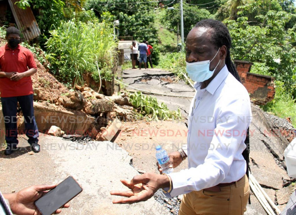 Minister of National Security, Fitzgerald Hinds speaks to the media about the damaged road on Abraham Lane, Pashley Street, Laventille.  Photo by Ayanna Kinsale