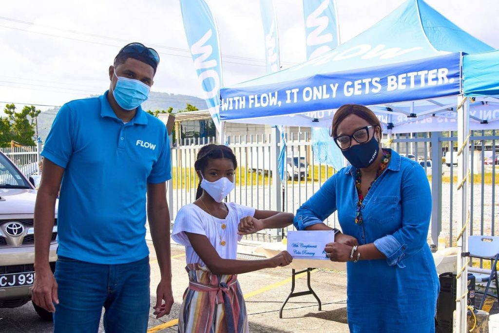 Flow vice president Simone Martin-Sulgan, presents a token to a young Analeigh Romany, while her dad Colin looks on. Photos courtesy Flow -