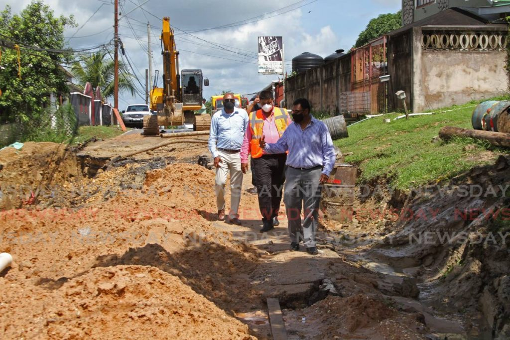 Minister of Works Rohan Sinanan, front, tours a landslip at Cipero Road, Borde Narve in Princes Town, on Tuesday accompanied by officials from the Ministry of Works and Transport. - Marvin Hamilton