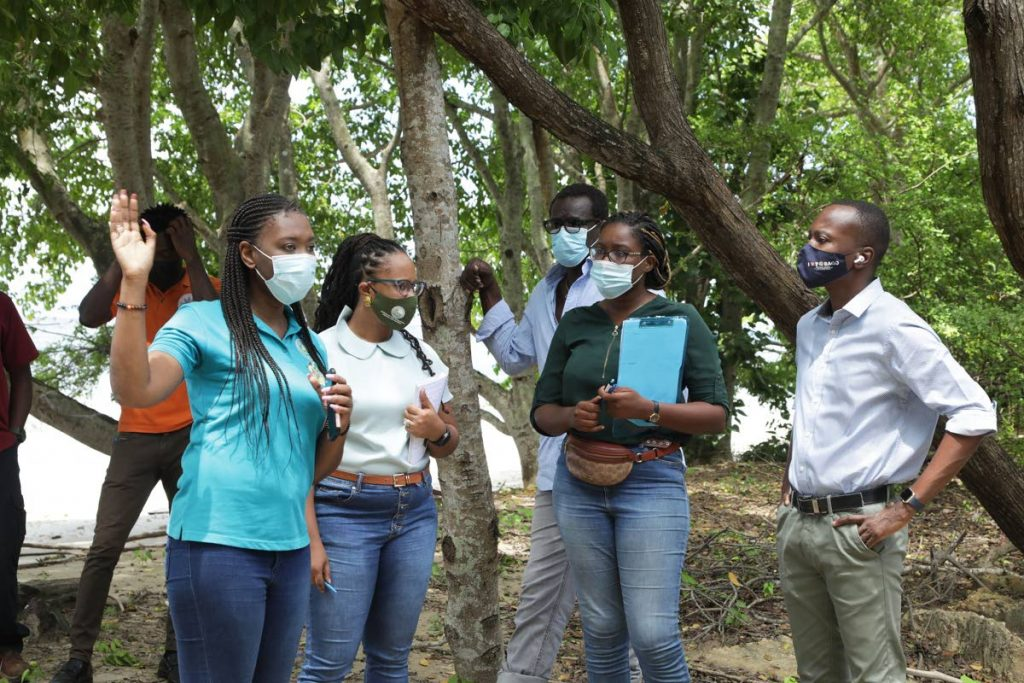 Chief Secretary Ancil Dennis, right, and a special-purpose team tour state lands on Tuesday ahead of distribution to farmers to boost the island's food production.  - Office of the Chief Secretary