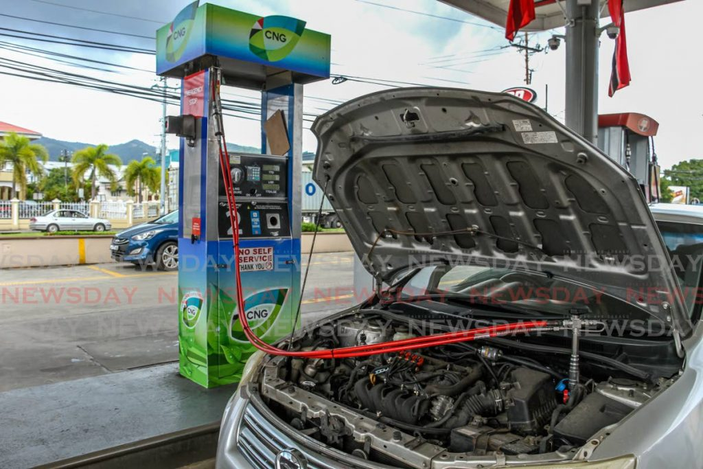CNG fuel is pumped into a car at St Christopher's service station in Port of Spain. - PHOTO BY AYANNA KINSALE