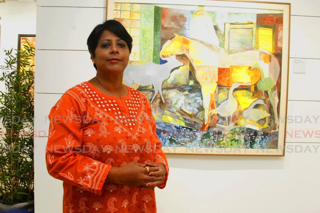 Sasmita Mishra Sahu gave up her position as an economics lecturer  to do art full-time. Alongside is one of her pieces Horse in the Shower in her exhibition The Moorings at Horizon Art Gallery, Mucurapo Road, St James.  - PHOTO BY ROGER JACOB
