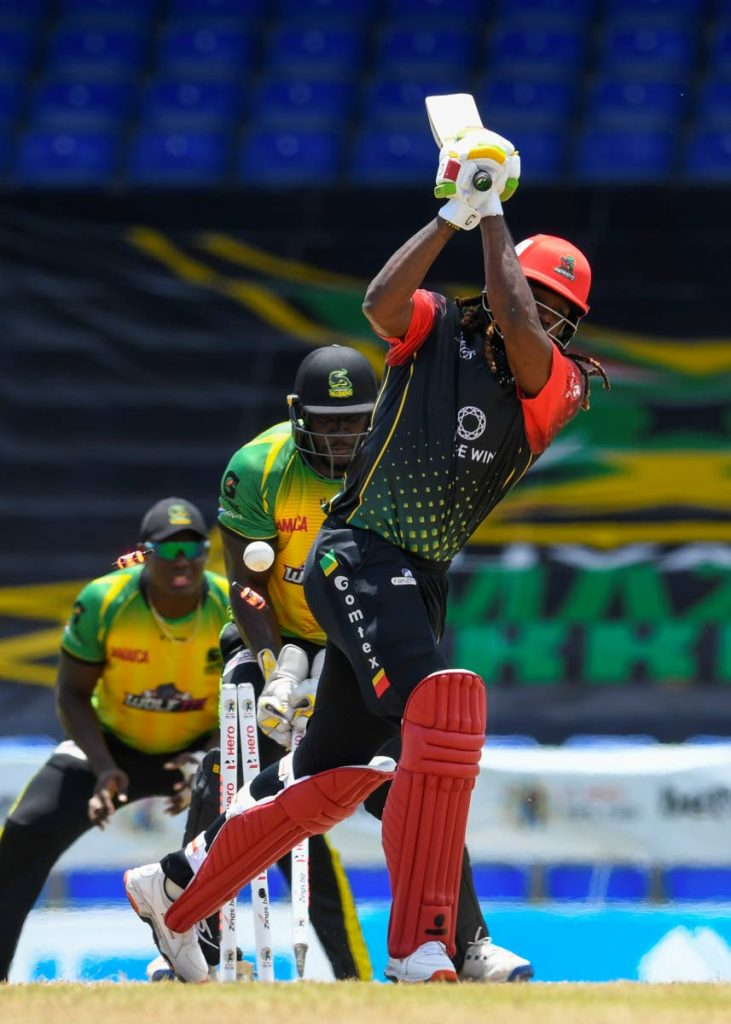 Chris Gayle (R) of Saint Kitts & Nevis Patriots is bowled by Chris Green of Jamaica Tallawahs during the 2021 Hero Caribbean Premier League match 21 at Warner Park Sporting Complex on September 8, in Basseterre, St Kitts. - Photo courtesy CPL T20