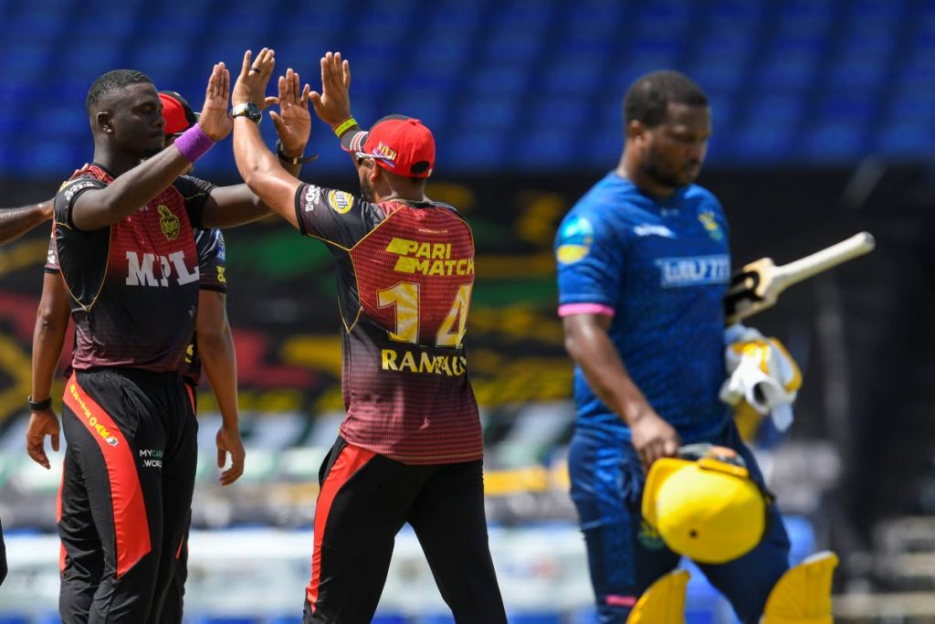 Jayden Seales (L) of Trinbago Knight Riders celebrates the dismissal of Johnson Charles (R) of Barbados Royals during the 2021 Hero Caribbean Premier League match 23 at Warner Park Sporting Complex on Thursday, in Basseterre, St Kitts - Photo courtesy CPL T20