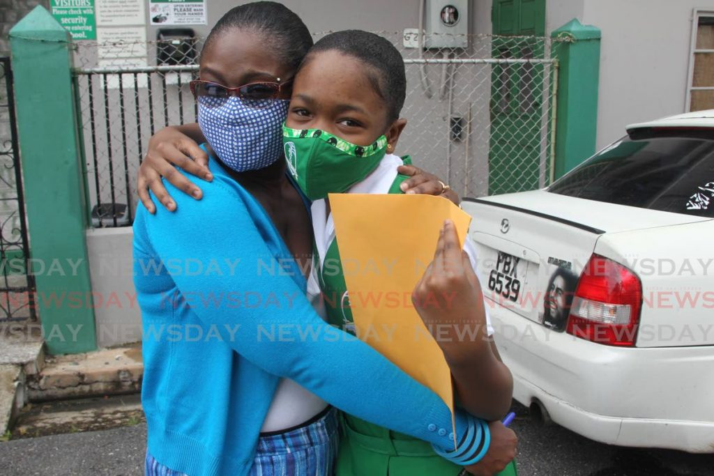 Alana Alexander congratulates her daughter Seanique Alexander after receiving her SEA results at the St Gabriel's girls primary school San Fernand - Lincoln Holder