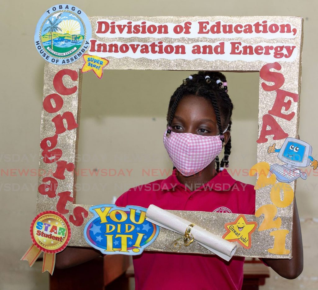 Raeya Charles, of St Andrews Anglican Primary School, placed second among Tobago students in the SEA examination and was recognised for her achievement at Calder Hall on Thursday. - PHOTO BY DAVID REID