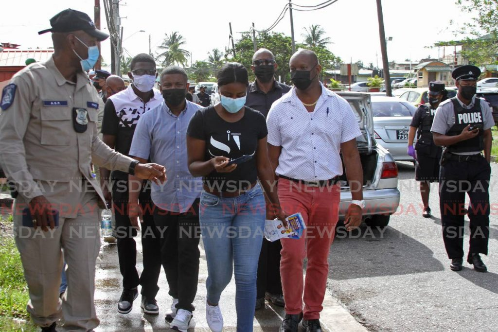 Councillors Robert Paris, Teresa Lynch and Nigel Couttier walked the community of Pleasantville with police on Thursday afternoon. - Photo by  Marvin Hamilton