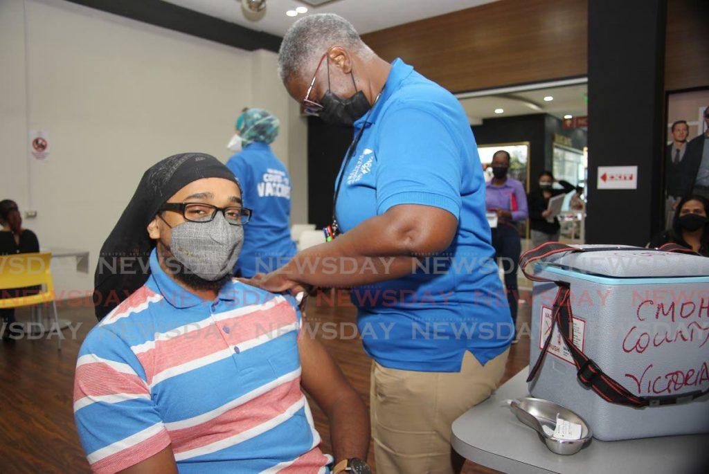 Tarodale resident Derich Ramlal took his Johnson & Johnson vaccine at C3 mall San Fernando as SWRHA continue their vaccine drive. - Photo by Lincoln Holder
