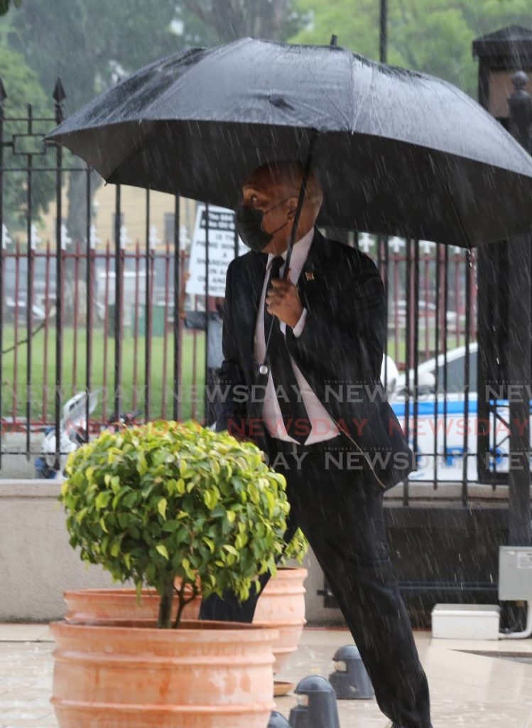 Senator Anil Roberts arriving in rain at the Red House in Port of Spain - Photo by Sureash Cholai