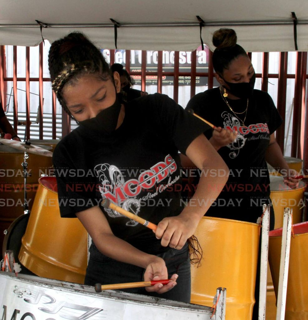 Moods Steel Orchestra players add a light mood to the vaccination drive at East Grove, Curepe last weekend. - Photo by Angelo Marcelle