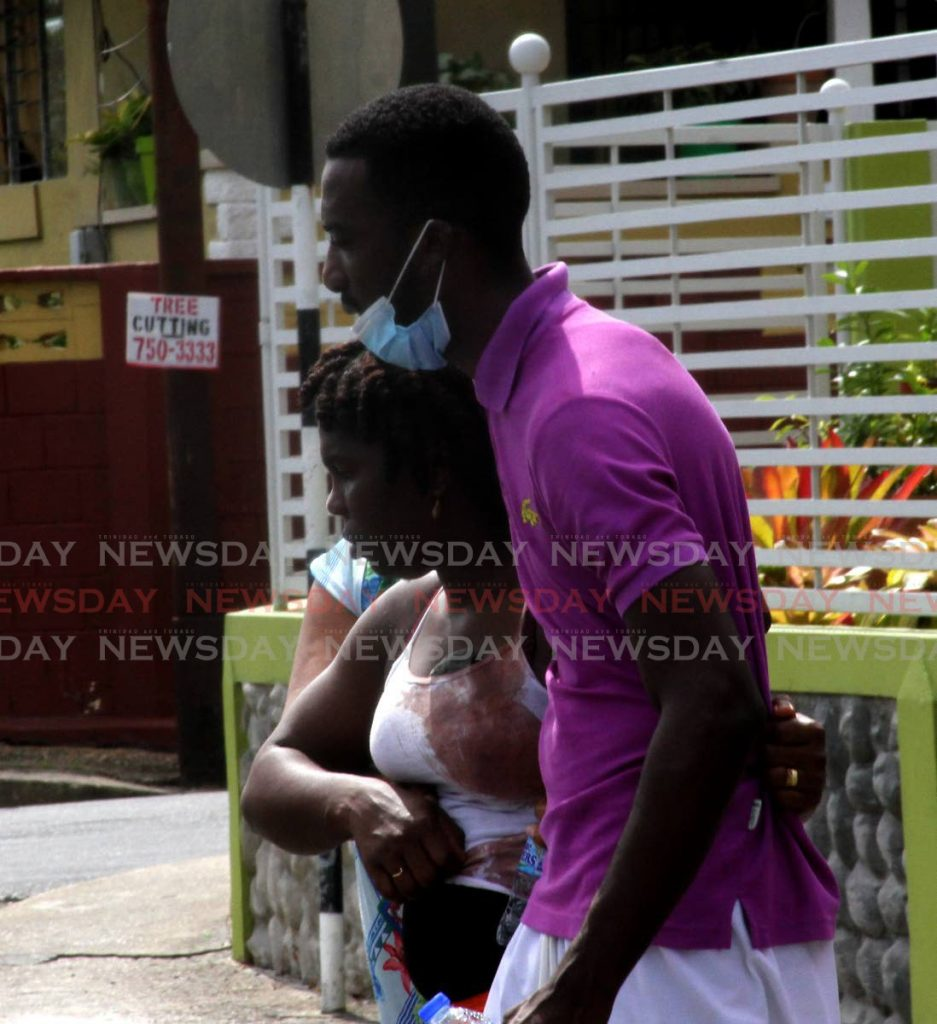 File photo: Mother of Amaziah Lewis 4, is comforted by a relative as she leaves K. Allen and Sons Funeral Directors, Arima on Sunday. Photo by Angelo Marcelle