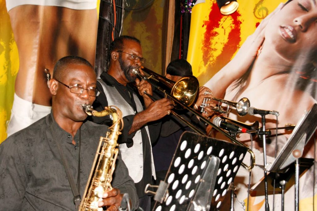 Patrick Spicer, second from left, performs with a brass section. -