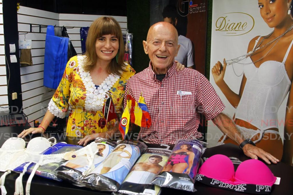 Father and daughter Luis Jose and Diane Botero at Pasarela apparel store in Port of Spain. The Venezuelan-Colombian family also owns several stores under the My Perfect Shape name. - PHOTO BY ROGER JACOB
