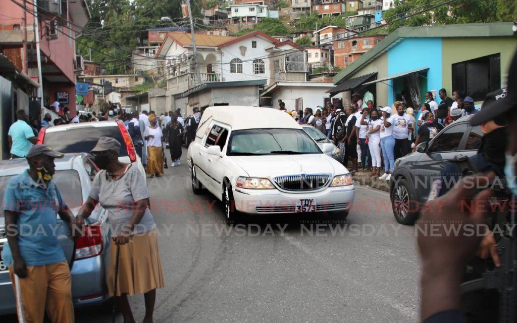 LAST JOURNEY: The hearse leaves the basketball court in John John, Laventille with the body of murdered reputed gang leader Anthon