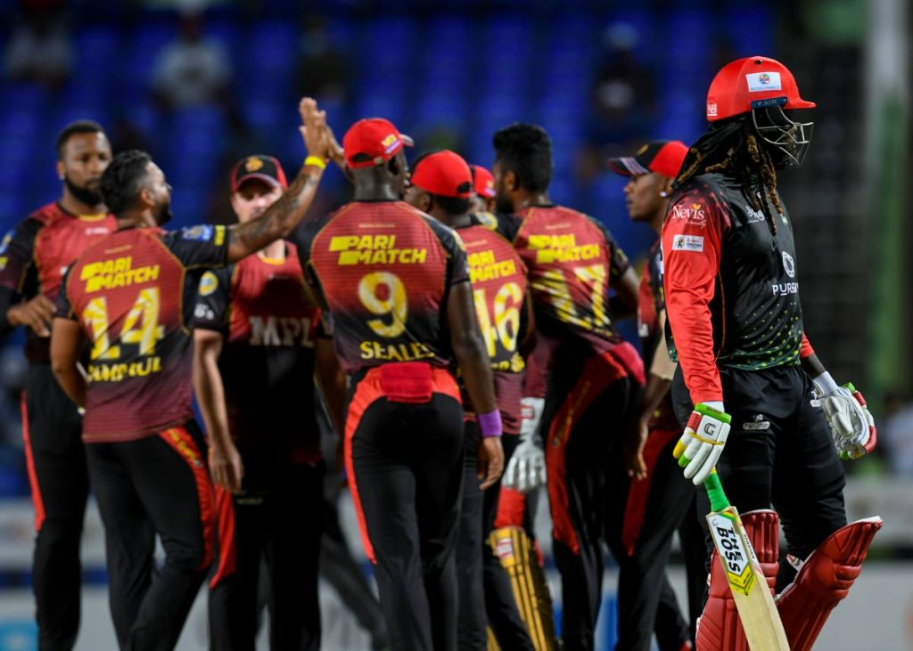 Chris Gayle (R) of St Kitts & Nevis Patriots walks off the field dismissed by Ravi Rampaul (2L) of Trinbago Knight Riders during the 2021 Hero Caribbean Premier League match 30 at Warner Park Sporting Complex on Sunday, in Basseterre, Saint Kitts  - Photo courtesy CPL T20