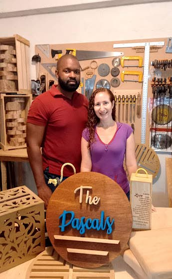 Husband-and-wife team of Personalize It Gift Shop Mandingo Pascal and Rachael Pascal with a family-themed creation. -