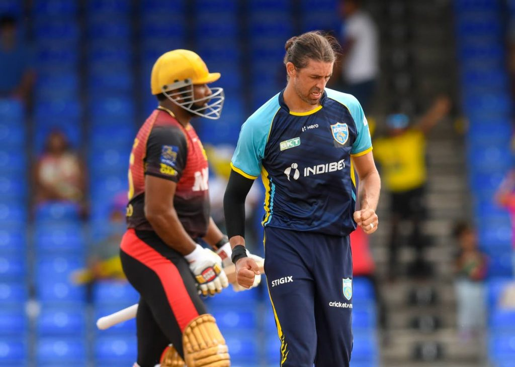 David Wiese (R) of Saint Lucia Kings celebrates the dismissal of Kieron Pollard (L) of Trinbago Knight Riders during the 2021 Hero Caribbean Premier League Play-Off match 31at Warner Park Sporting Complex on Tuesday, in Basseterre, St Kitts. - Photo courtesy CPL T20