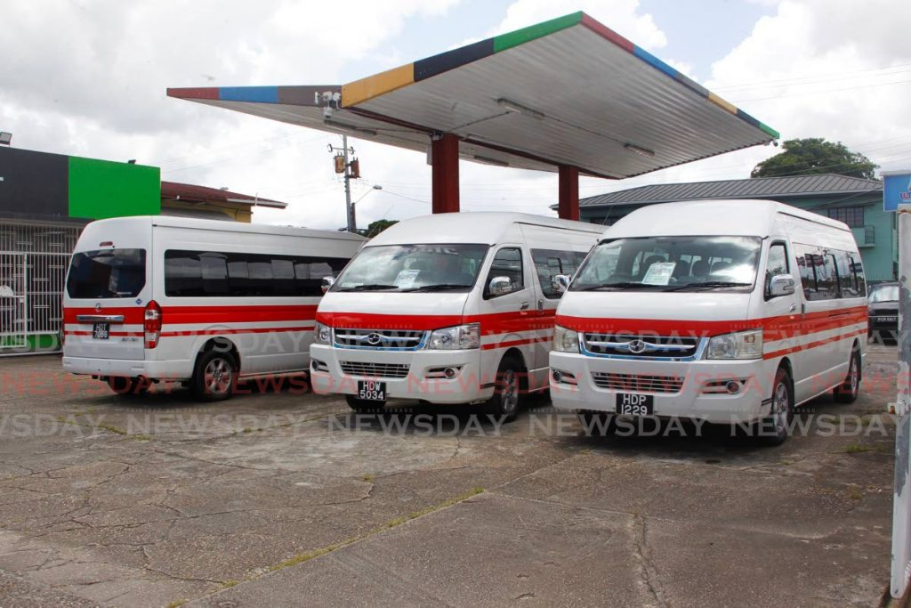 CNG-fuelled maxi taxis at Routes Auto's headquarters, a refurbished NP station, in Tunapuna. Photo by Roger Jacob