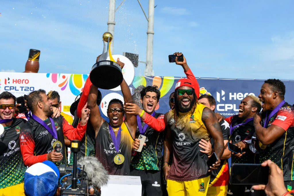 Dwayne Bravo (C) of Saint Kitts & Nevis Patriots celebrates with the trophy after winning the 2021 Hero Caribbean Premier League final against Saint Lucia Kings at Warner Park Sporting Complex on Wednesday, in Basseterre, St Kitts. - Photo courtesy CPL T20