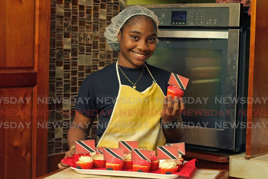 Shermia Pierre, owner of Mia Magical Designs, baked cup cakes topped with the national flag at her home in Mayaro. - Photo by Marvin Hamilton