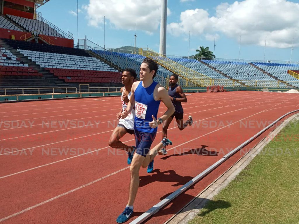 Stephon Gould of Richard Jones Racing, left, and Troy Llanos of Fatima College, middle, compete in the men's Under-23 1,500m event at the Pan Amercian Under-20 and Pan American Under-23 preparation meet at the Hasely Crawford Stadium in Port of Spain, on Sunday.  - Photo by Jelani Beckles