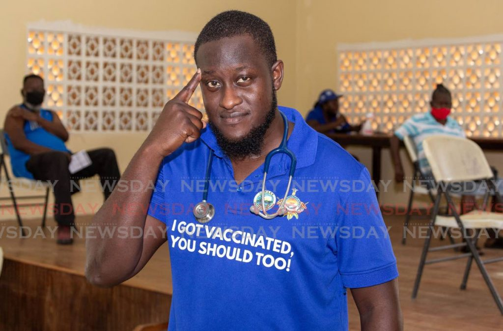 Dr Alimayu Chadband, primary care services house officer, Tobago Regional Health Authority, at the covid19 vaccination caravan, Mt Pleasant Community Centre, on Tuesday. - David Reid