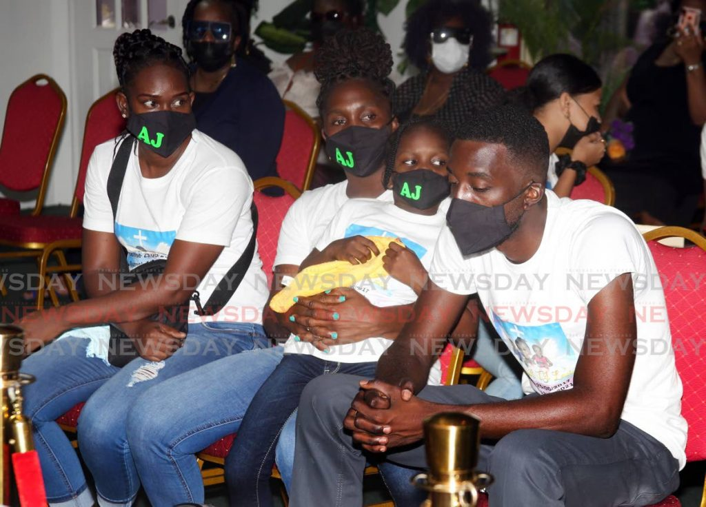 SORROW: Roxanne Lewis, 2nd from left, at the funeral for her son Amaziah, four, on Tuesday at the chapel of the Allen's Funeral Home in Arima. PHOTO BY SUREASH CHOLAI -