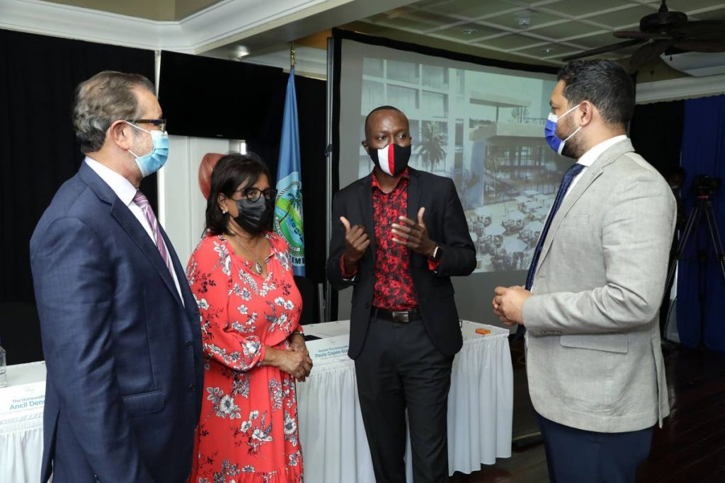 Chief Secretary and Secretary of Tourism Ancil Dennis, second from right, chats with Tourism Minister Randall Mitchell, right, eTeck chairman Imtiaz Ahamad, left, and Trade and Industry Minister Paula Gopee-Scoon at a press conference on Tuesday to announce a $500 million development project.   - Office of Chief Secretary
